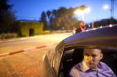 Naftali Bennett Head of HaBayit HaYehudi Party the Jewish Home party sits in his car during a campaign tour on December 26 2012 in Tel Aviv Israel...