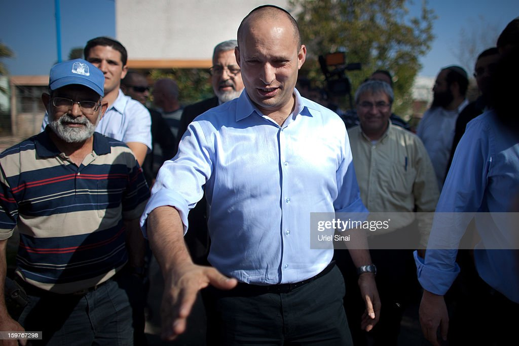 Naftali Bennett , head of HaBayit HaYehudi Party, the Jewish Home party, greets students at a pre-army training school as he campaigns in the Shapira Center on January 20, 2013 near Ashkelon, Israel. The religious Jewish Home party is challenging Benjamin Netanyahu's Likud party as Israel heads for a general election on January 22.
