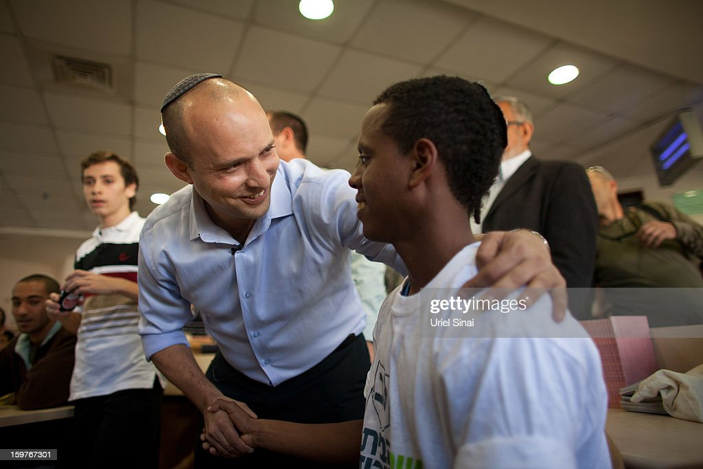 Naftali Bennett (L), head of HaBayit HaYehudi Party, the Jewish Home party, greets students at a pre-army training school as he campaigns in the Shapira Center on January 20, 2013 near Ashkelon, Israel. The religious Jewish Home party is challenging Benjamin Netanyahu's Likud party as Israel heads for a general election on January 22.