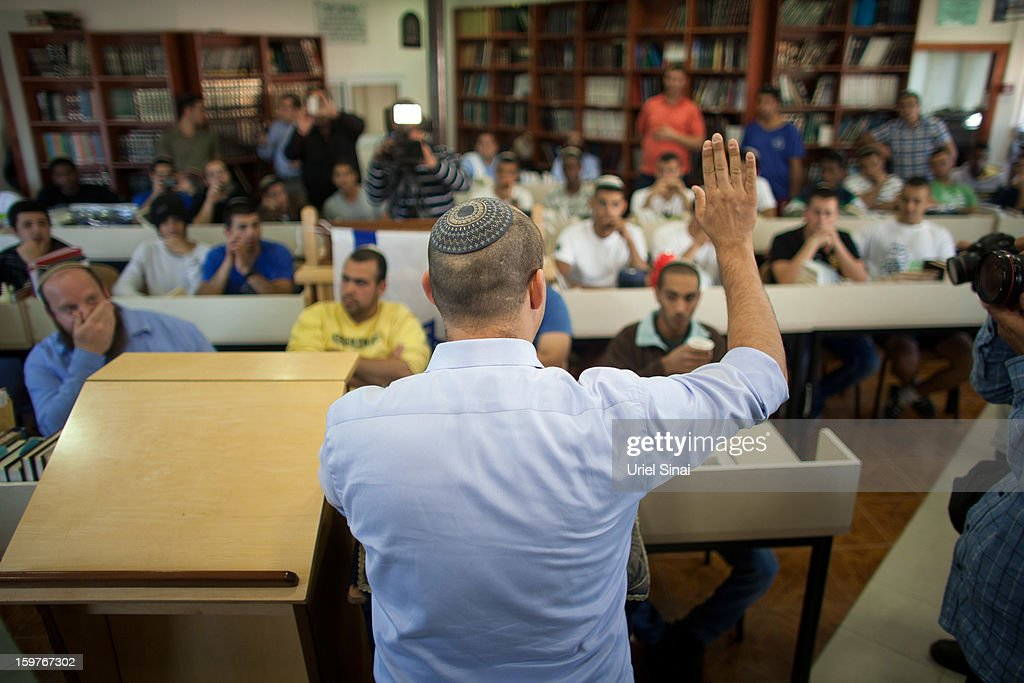 Naftali Bennett (L), head of HaBayit HaYehudi Party, the Jewish Home party, talks to students at a pre-army training school as he campaigns in the Shapira Center on January 20, 2013 near Ashkelon, Israel. The religious Jewish Home party is challenging Benjamin Netanyahu's Likud party as Israel heads for a general election on January 22.