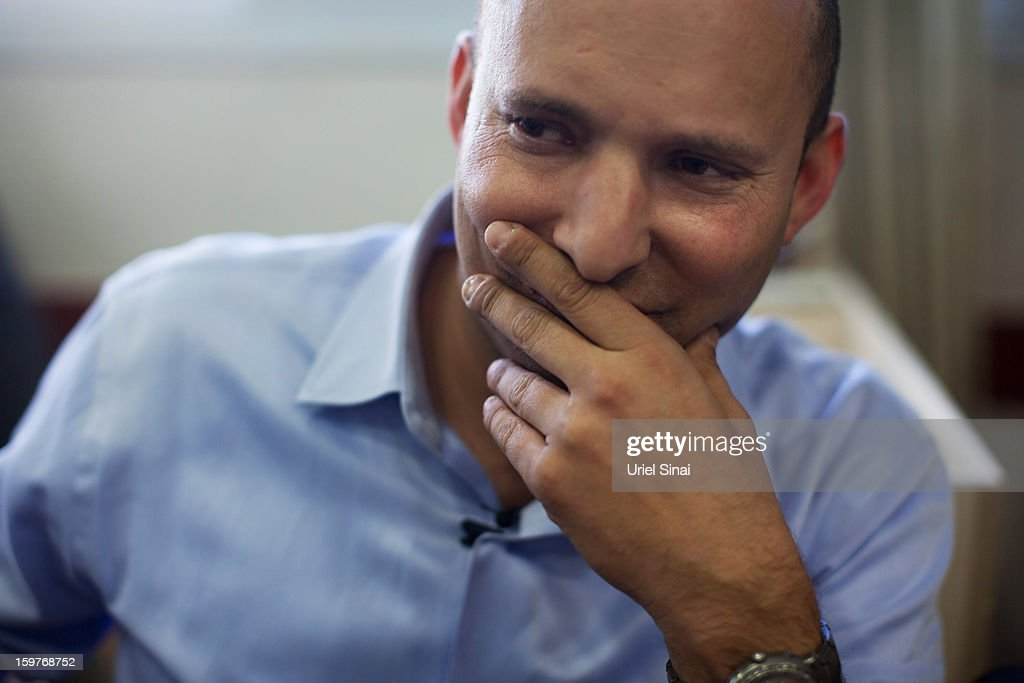 Naftali Bennett, head of HaBayit HaYehudi Party, the Jewish Home party, looks on as he talks to students at a pre-army training school as he campaigns at the Shapira Center on January 20, 2013 near Ashkelon, Israel. The religious Jewish Home party is challenging Benjamin Netanyahu's Likud party as Israel heads for a general election on January 22.