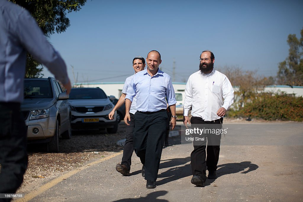 Naftali Bennett (2nd R), head of HaBayit HaYehudi Party, the Jewish Home party, arrives at a pre-army training school as he campaigns at the Shapira Center on January 20, 2013 near Ashkelon, Israel. The religious Jewish Home party is challenging Benjamin Netanyahu's Likud party as Israel heads for a general election on January 22.