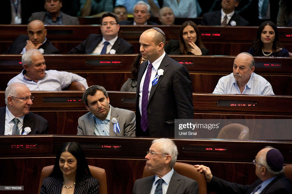 <a gi-track='captionPersonalityLinkClicked' href=/galleries/search?phrase=Naftali+Bennett&family=editorial&specificpeople=6632880 ng-click='$event.stopPropagation()'>Naftali Bennett</a>, head of Israel's Jewish Home party attends the swearing-in ceremony of the 19th Knesset, the new Israeli parliament, on February 5, 2013 in Jerusalem, Israel. The 120 members of the Knesset included a record 48 new law makers.