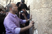 Naftali Bennett head of the Habayit Hayehudi party the Jewish Home party during a visit to the Western Wall Judaism's holiest site on January 21 2013...