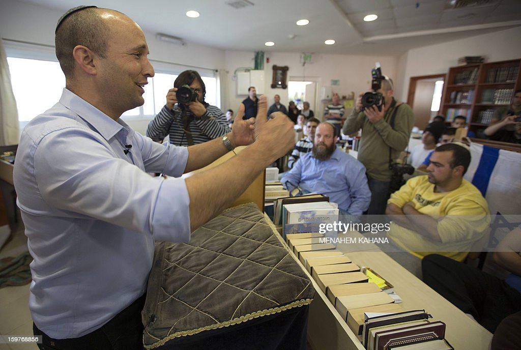 Naftali Bennett, head of the Israeli hardline national religious party, Jewish Home, talks to students at a pre-military Yeshiva (religious school) in the village of Merkaz Shapira, 16 kilometres north-east of Ashkelon during a campaign visit on January 20, 2013. Israeli soldiers headed to the polls, two days ahead of a general election, the military said, as politicians made last-ditch appeals before nationwide voting gets underway on January 22.