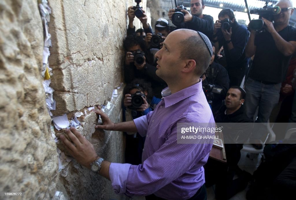 Naftali Bennett (C), head of the Israeli hardline national religious party, Jewish Home, visits the Western Wall, Judaism holiest site, during a tour in Jerusalem's old city on January 21, 2013. With less than 24 hours until Israelis vote in general elections, party leaders were campaigning down to the wire ahead of a ballot seen returning Prime Minister Benjamin Netanyahu to office.