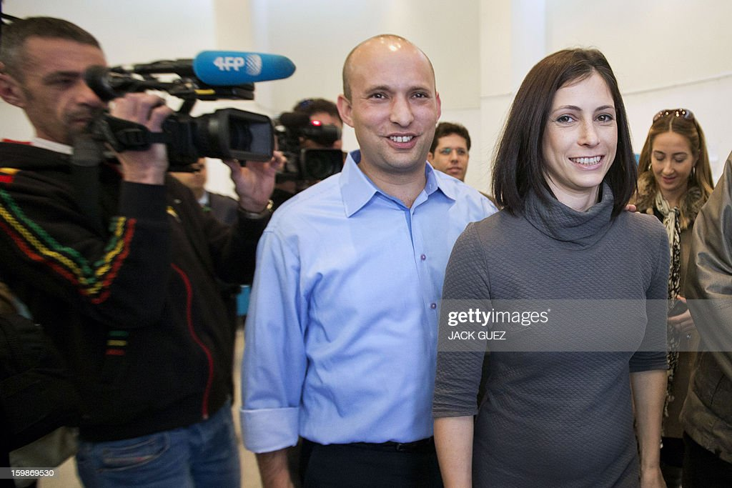 Naftali Bennett (C), head of the Israeli hard-line national religious party, Jewish Home, and his wife Gilat (R) after voting at a polling station in Raanana, central Israel, on January 22, 2013.