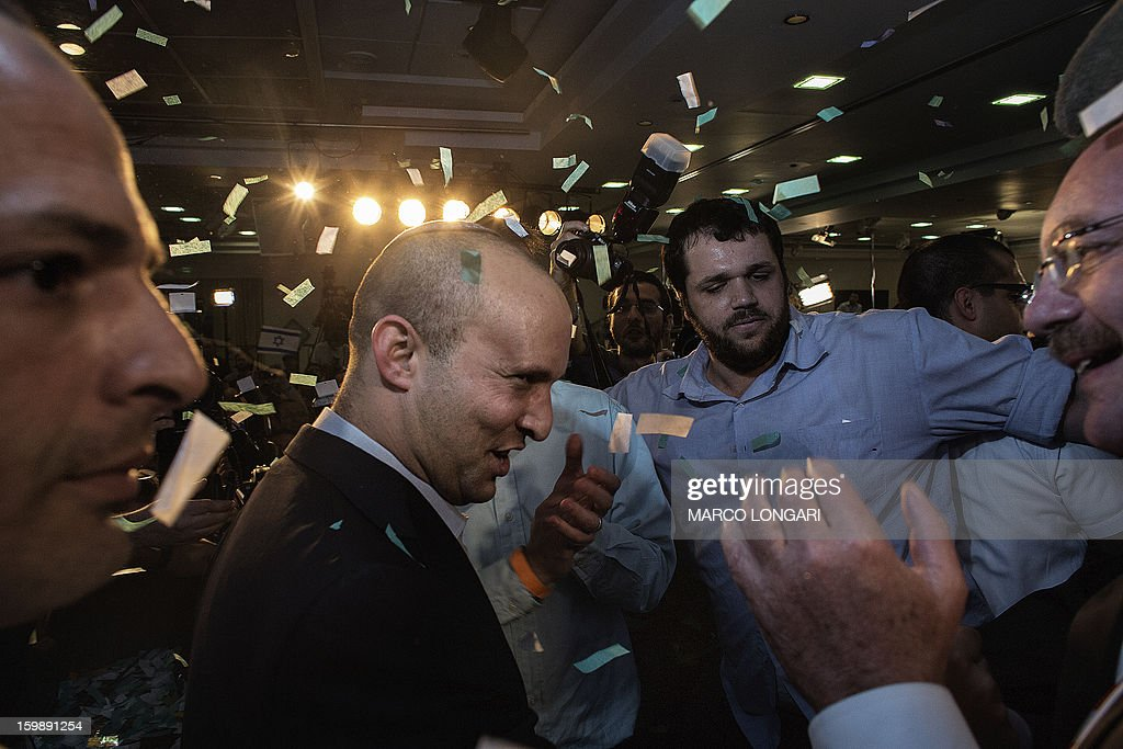 Naftali Bennett (C), head of the Israeli hard-line national religious party, Jewish Home, acknowledges supporters at the Kfar Maccabia hotel in Tel Aviv for the celebratory party at the end of the elections on January 22, 2013. Israeli Prime Minister Benjamin Netanyahu said it was necessary to form the 'broadest possible government' after his Likud-Beitenu list won a narrow election victory, with the centrist Yesh Atid in second place.