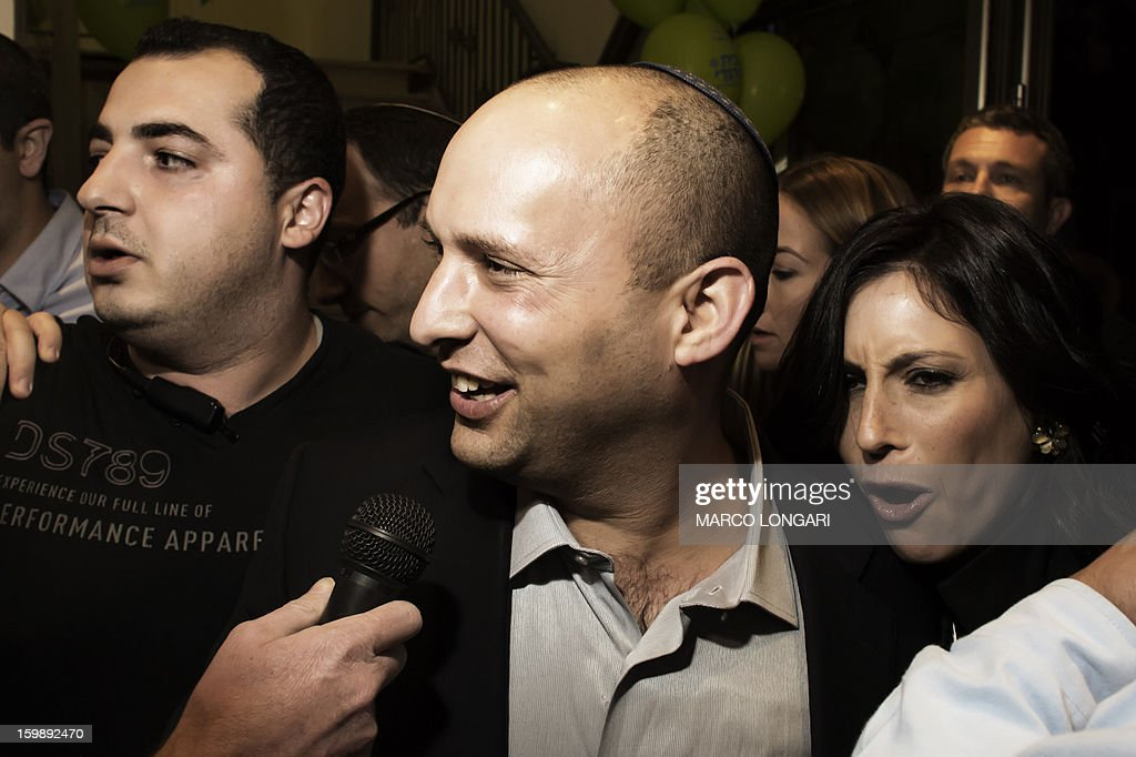 Naftali Bennett (C), head of the Israeli hard-line national religious party, Jewish Home, is surrounded by supporters as he arrives at the Kfar Maccabia hotel in Tel Aviv for the celebratory party at the end of the elections on January 22, 2013. Israeli Prime Minister Benjamin Netanyahu said it was necessary to form the 'broadest possible government' after his Likud-Beitenu list won a narrow election victory, with the centrist Yesh Atid in second place.