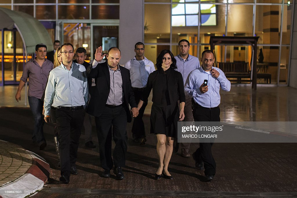 Naftali Bennett (C), head of the Israeli hard-line national religious party Jewish Home, holds hands with and his wife Gilat as he arrives at the conference room the Kfar Maccabia hotel in Tel Aviv for the celebratory party at the end of the elections, on January 22, 2013. Israeli Prime Minister Benjamin Netanyahu said it was necessary to form the 'broadest possible government' after his Likud-Beitenu list won a narrow election victory, with the centrist Yesh Atid in second place.