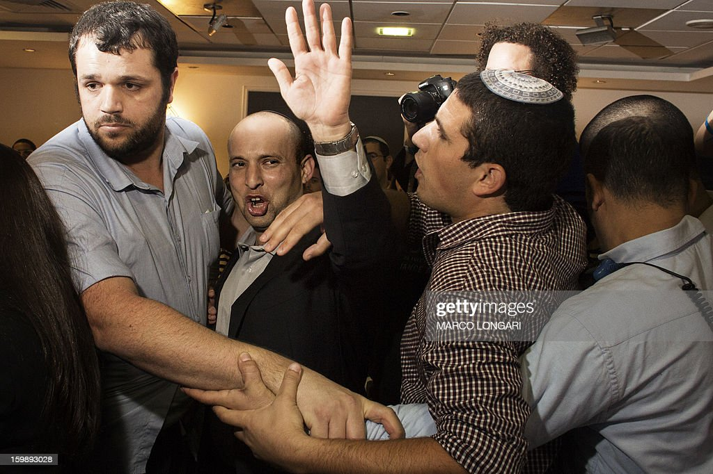 Naftali Bennett, head of the Israeli hard-line national religious party, Jewish Home, waves to supporters at the Kfar Maccabia hotel in Tel Aviv for the celebratory party at the end of the elections on January 22, 2013. Israeli Prime Minister Benjamin Netanyahu said it was necessary to form the 'broadest possible government' after his Likud-Beitenu list won a narrow election victory, with the centrist Yesh Atid in second place. AFP PHOTO/MARCO LONGARI