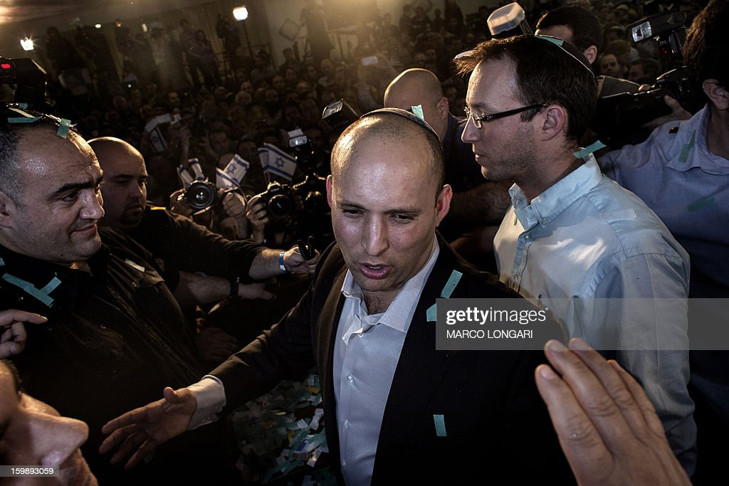 Naftali Bennett, head of the Israeli hard-line national religious party, Jewish Home, greets supporters at the Kfar Maccabia hotel in Tel Aviv for the celebratory party at the end of the elections on January 22, 2013. Israeli Prime Minister Benjamin Netanyahu said it was necessary to form the 'broadest possible government' after his Likud-Beitenu list won a narrow election victory, with the centrist Yesh Atid in second place. AFP PHOTO/MARCO LONGARI