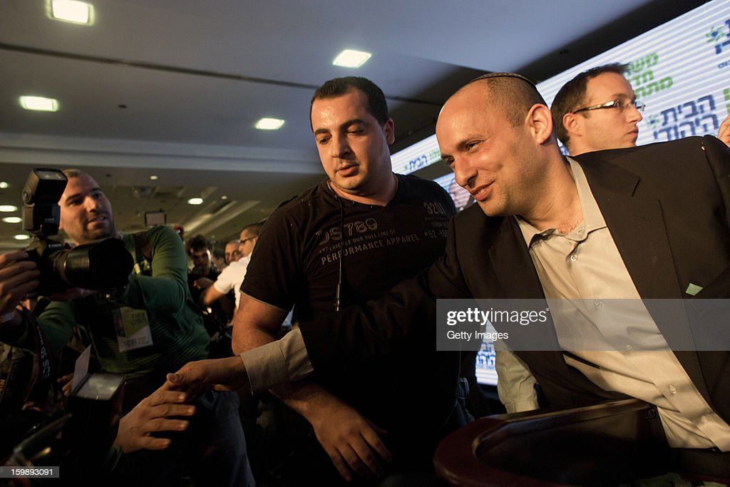Naftali Bennett (R), leader of the Habayit Hayehudi party (The Jewish Home) greets supporters and activists from his party at a post-election rally on January 22, 2013 in Ramat Gan, Israel. Polls are predicting 12 seats of 120 in the Israeli parliament for the right-wing, religious party led by Naftali Bennett, with Israel seeing the highest turnout of voters since 1999.