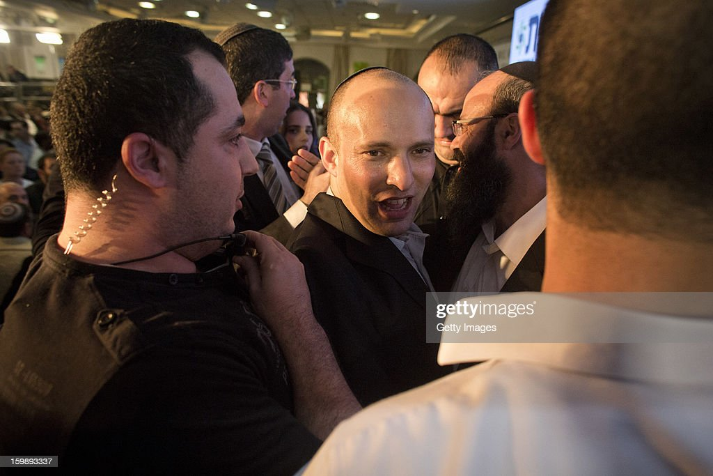 <a gi-track='captionPersonalityLinkClicked' href=/galleries/search?phrase=Naftali+Bennett&family=editorial&specificpeople=6632880 ng-click='$event.stopPropagation()'>Naftali Bennett</a> (C), leader of the Habayit Hayehudi party (The Jewish Home) greets supporters and activists from his party at a post-election rally on January 22, 2013 in Ramat Gan, Israel. Polls are predicting 12 seats of 120 in the Israeli parliament for the right-wing, religious party led by <a gi-track='captionPersonalityLinkClicked' href=/galleries/search?phrase=Naftali+Bennett&family=editorial&specificpeople=6632880 ng-click='$event.stopPropagation()'>Naftali Bennett</a>, with Israel seeing the highest turnout of voters since 1999.