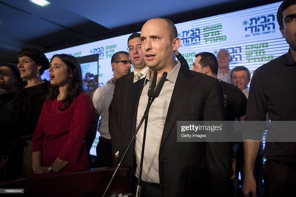 Naftali Bennett, leader of the Habayit Hayehudi party (The Jewish Home) speaks to supporters and activists from his party at a post-election rally on January 22, 2013 in Ramat Gan, Israel. Polls are predicting 12 seats of 120 in the Israeli parliament for the right-wing, religious party led by Naftali Bennett, with Israel seeing the highest turnout of voters since 1999.
