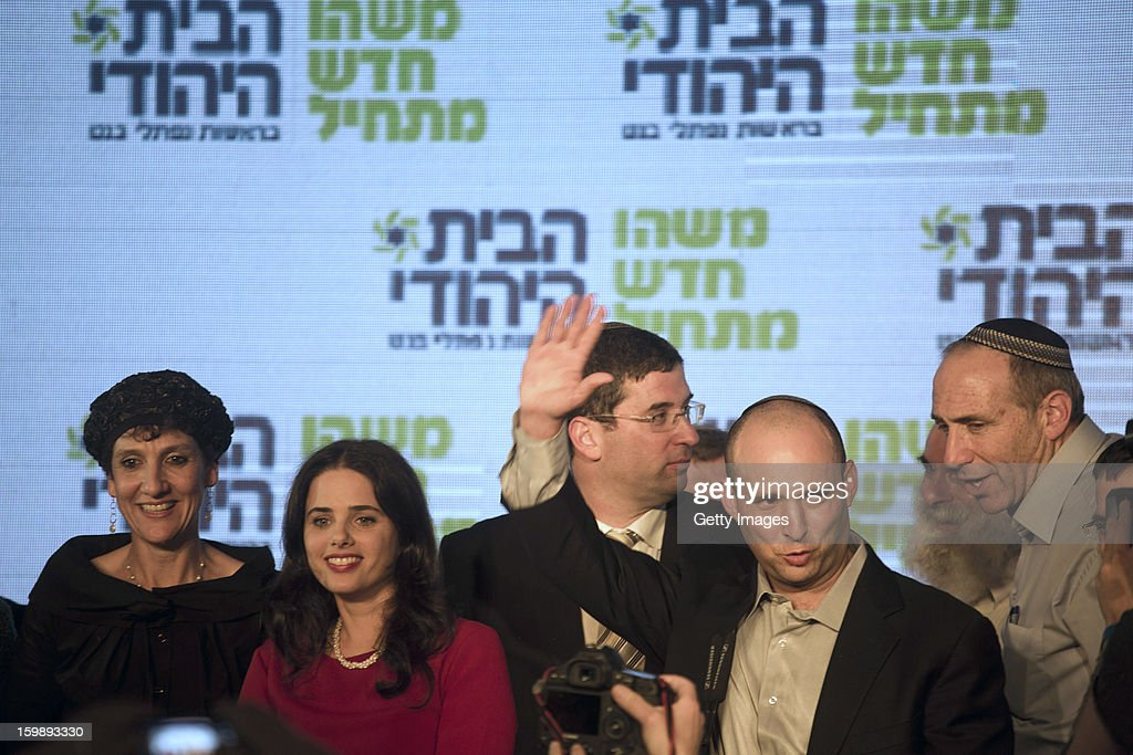 Naftali Bennett (R), leader of the Habayit Hayehudi party (The Jewish Home) waves to supporters from his party at a post-election rally on January 22, 2013 in Ramat Gan, Israel. Polls are predicting 12 seats of 120 in the Israeli parliament for the right-wing, religious party led by Naftali Bennett, with Israel seeing the highest turnout of voters since 1999.
