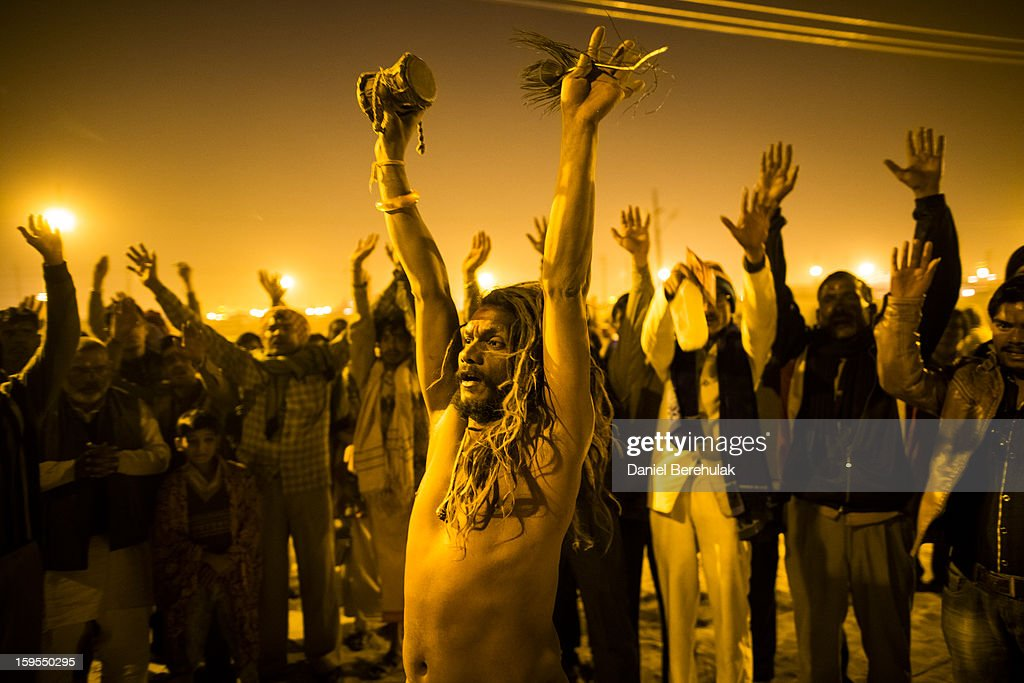 A naga sadhu performs for donations during an aarti ceremony on the banks of the Ganges river, during the Maha Kumbh Mela on January 15, 2013 in Allahabad, India. The Maha Kumbh Mela, believed to be the largest religious gathering on earth is held every 12 years on the banks of Sangam, the confluence of the holy rivers Ganga, Yamuna and the mythical Saraswati. The Kumbh Mela alternates between the cities of Nasik, Allahabad, Ujjain and Haridwar every three years. The Maha Kumbh Mela celebrated at the holy site of Sangam in Allahabad, is the largest and holiest, celebrated over 55 days, it is expected to attract over 100 million people.