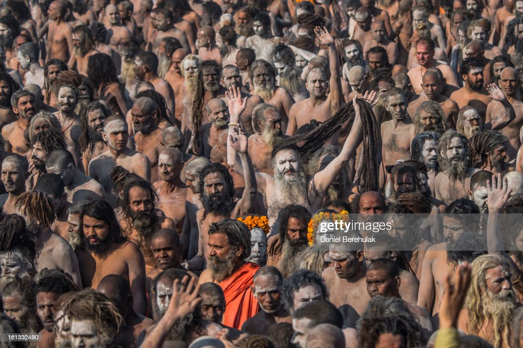 Naga Sadhus, naked Hindu holy men, walk in procession after having bathed on the banks of Sangam, the confluence of the holy rivers Ganges, Yamuna and the mythical Saraswati, on the auspicious bathing day of Mauni Amavasya during the Maha Kumbh Mela on February 10, 2013 in Allahabad, India. The Maha Kumbh Mela, believed to be the largest religious gathering on earth, is held every 12 years on the banks of Sangam, the confluence of the holy rivers Ganga, Yamuna and the mythical Saraswati. The Kumbh Mela alternates between the cities of Nasik, Allahabad, Ujjain and Haridwar every three years. The Maha Kumbh Mela celebrated at the holy site of Sangam in Allahabad, is the largest and holiest, celebrated over 55 days, and is expected to attract over 100 million people.