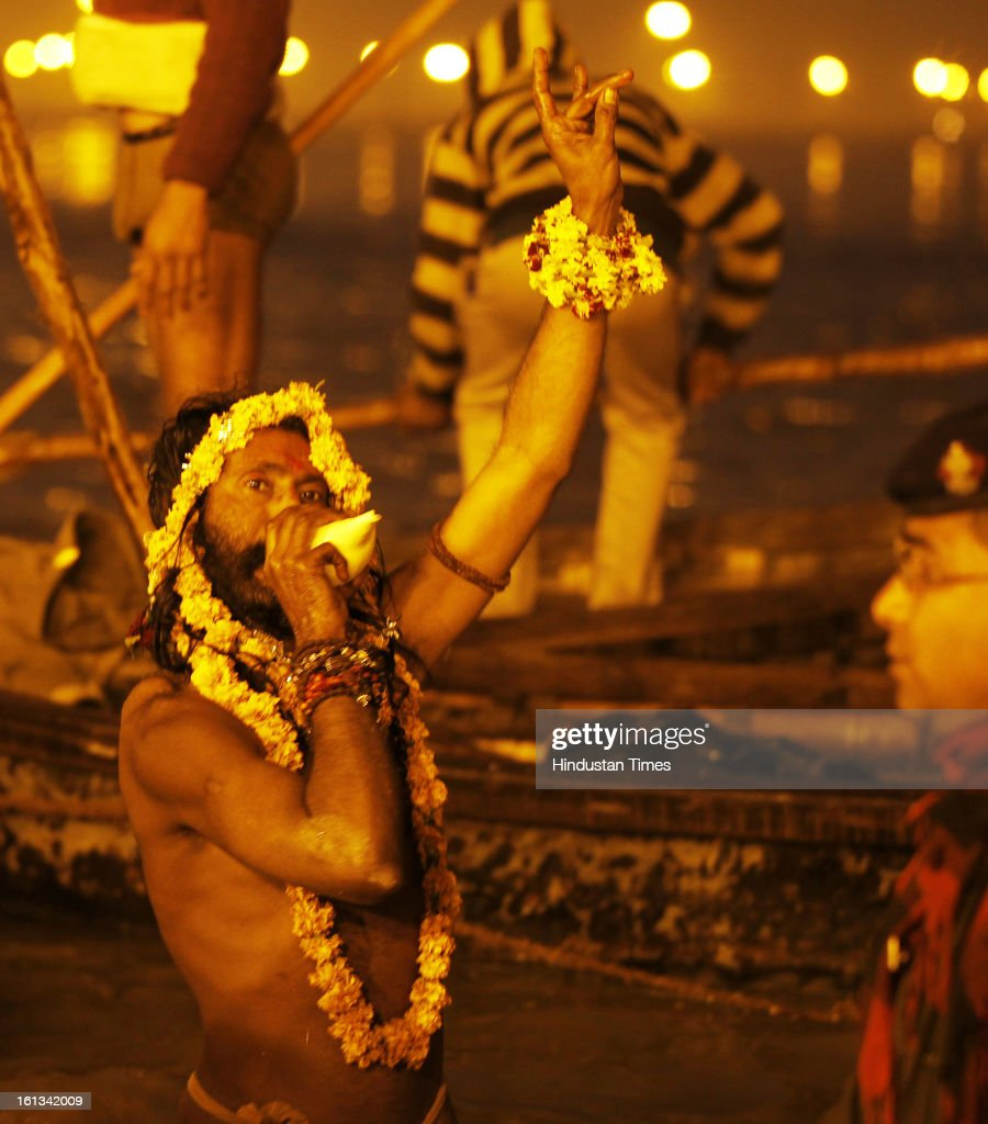 Naga Sadhus take Shahi Snan (royal bath) at the bank of Sangam confluence of river Ganga, Yamnuna and mythical Saraswati on the occasion of Mauni Amawasya on February 10, 2013 in Allahabad, India. Tens of millions of Hindus gathered Sunday for a holy bath in India's sacred river Ganges on the most auspicious day of the world's largest religious festival.