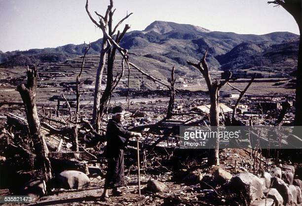 Nagasaki reduced to rubble and ruins by the atomic bomb In the foreground a victim of the radiations Dr Nagai expert at the Nagasaki hospital He died...