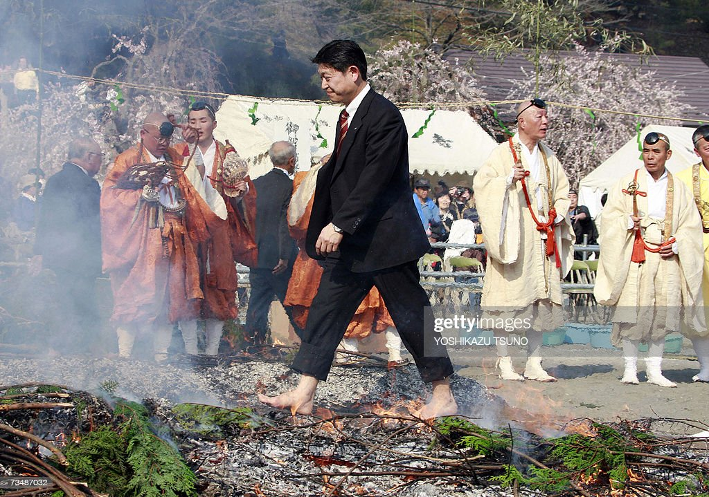 A Buddhism believer takes part in the traditional 'hi-watari', or fire-walking ritual, which heralds the coming of spring, at the Chichibu Fire Festival in the town of Nagatoro, outside Tokyo in Saitama prefecture, 04 March 2007. Hundreds of people followed Buddhist ascetics and participated in fire walking for 'purifying their mind and body' and to pray for good health and safety. AFP PHOTO / Yoshikazu TSUNO