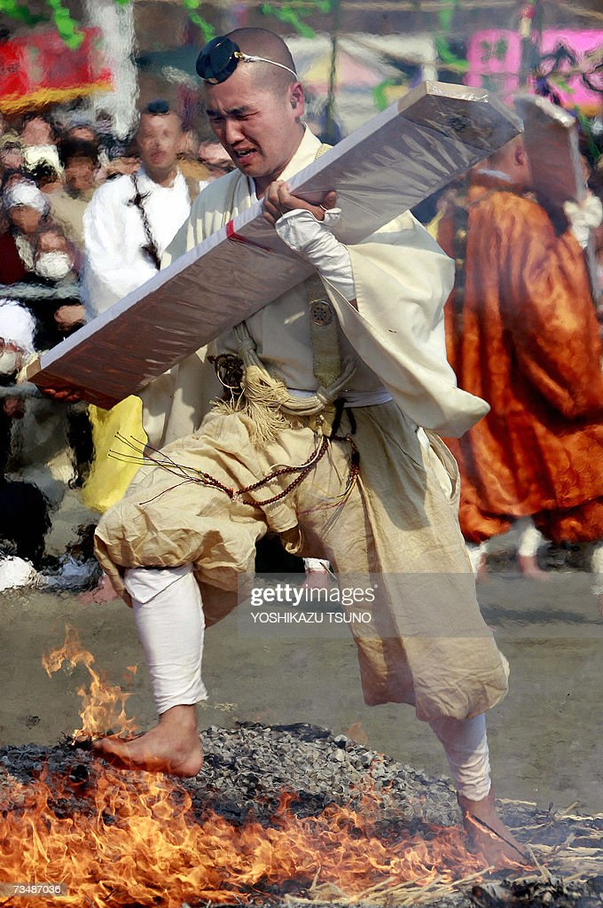 A Buddhist monk walks barefoot over fire as he takes part in the traditional 'hi-watari', or fire-walking ritual, which heralds the coming of spring, at the Chichibu Fire Festival in the town of Nagatoro, outside Tokyo in Saitama prefecture, 04 March 2007. Hundreds of people followed Buddhist ascetics and participated in fire walking for 'purifying their mind and body' and to pray for good health and safety. AFP PHOTO / Yoshikazu TSUNO