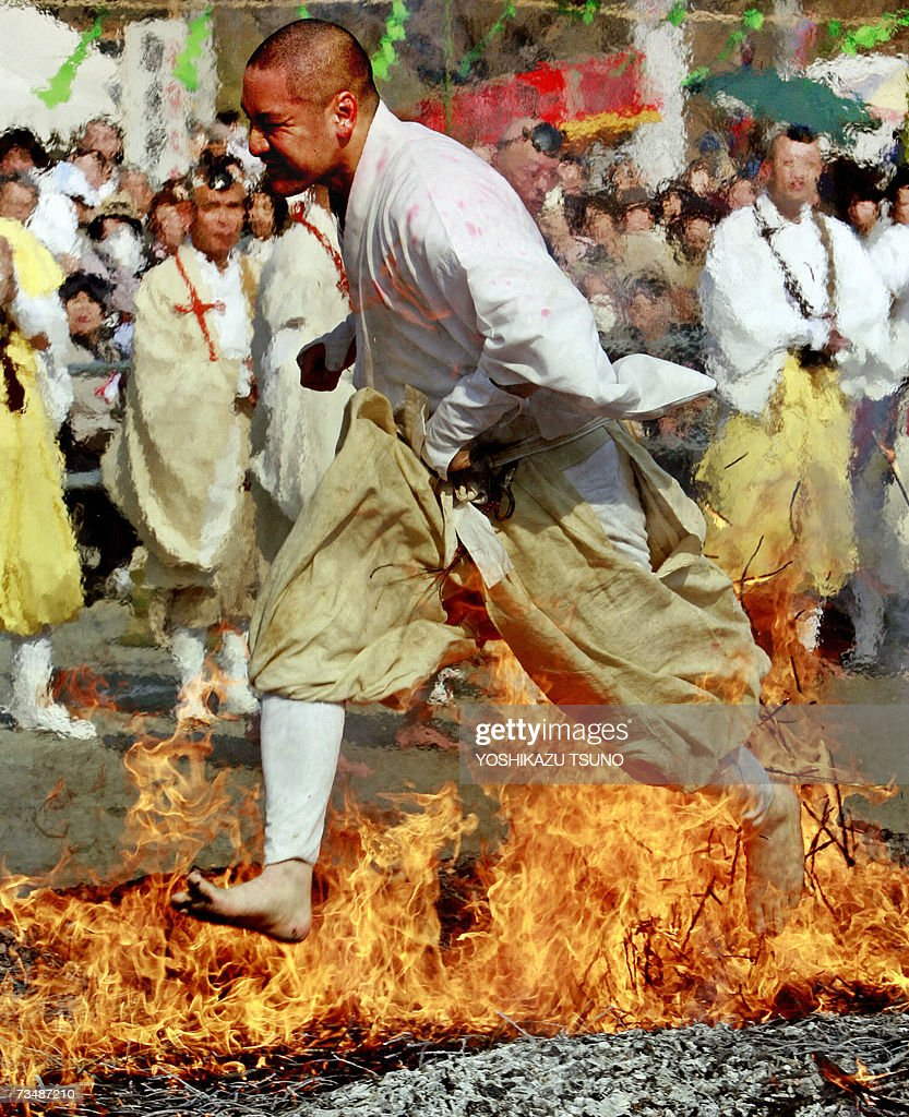 A Buddhist monk walks barefoot over fire in a ritual ceremony which heralds the coming of spring at the Chichibu fire festival in Nagatoro town, suburban Tokyo, 04 March 2007. Hundreds of people follow the Buddhist ascetics to participate the fire walking for 'purifying their mind and body' and to pray for good health and safety. AFP PHOTO / Yoshikazu TSUNO