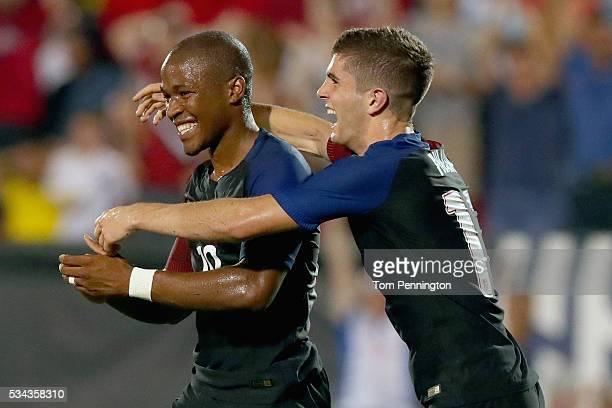 Nagbe Darlington of the United States celebrates with Christian Pulisic of the United States after scoring against Ecuador during an International...