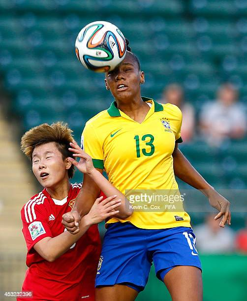 Nagela of Brazil wins a header over Zhang Chen of China PR at Commonwealth Stadium on August 5 2014 in Edmonton Canada