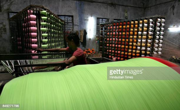 Nagesh Pujari working at a traditional power loom in Solapur