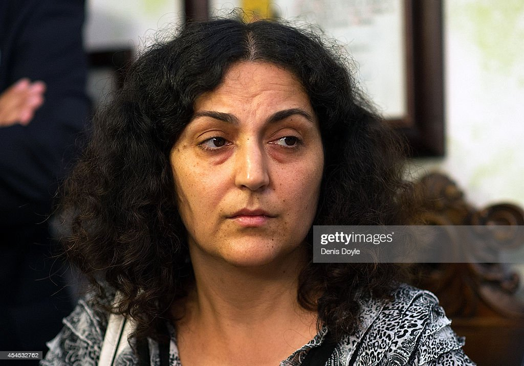 Naghmeh King, mother of five year old Ashya King, looks on while her husband Brett speaks during a press conference at their lawyer's office on September 3, 2014 in Seville, Spain. Brett and Naghmeh King were released from a Madrid prison late on September 2nd, after British authorities dropped an extradition request. Ashya King, who has a brain tumour, had been taken by his parents from a UK hospital against medical advice.