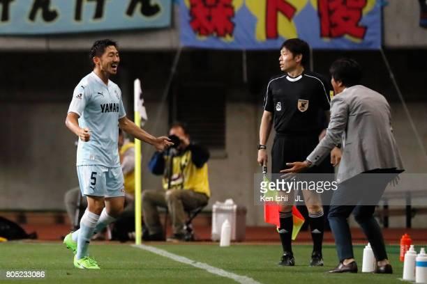 Nagisa Sakurauchi of Jubilo Iwata celebrates scoring his side's second goal with head coach Hiroshi Nanami during the JLeague J1 match between...