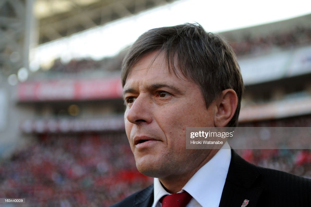 Nagoya Grampus head coach <a gi-track='captionPersonalityLinkClicked' href=/galleries/search?phrase=Dragan+Stojkovic&family=editorial&specificpeople=625216 ng-click='$event.stopPropagation()'>Dragan Stojkovic</a> looks on prior to the J.League match between Urawa Red Diamonds and Nagoya Grampus at Saitama Stadium on March 9, 2013 in Saitama, Japan.