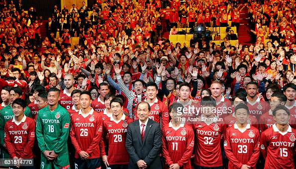 Nagoya Grampus head coach Yahiro Kazama and players pose with supporters during the Nagoya Grampus team unveiling event on January 15 2017 in Nagoya...