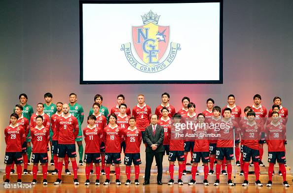 Nagoya Grampus head coach Yahiro Kazama and players stand on stage during the Nagoya Grampus team unveiling event on January 15 2017 in Nagoya Aichi...