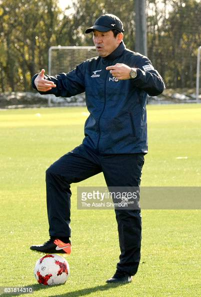 Nagoya Grampus head coach Yahiro Kazama instructs players during a training session at Toyota Sports Center on January 16 2017 in Toyota Aichi Japan