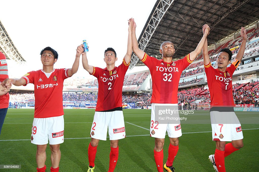 Nagoya Grampus players celebrate their 3-1 win in the J.League match between Nagoya Grampus and Yokohama F.Marinos at the Toyota Stadium on May 4, 2016 in Toyota, Aichi, Japan.