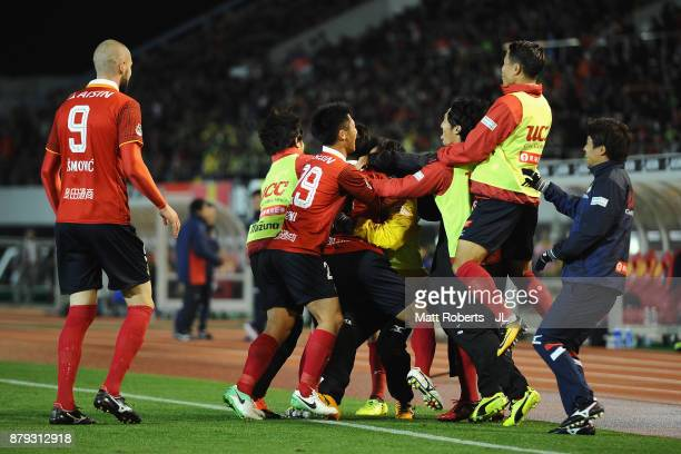 Nagoya Grampus players celebrate their team's first goal by Taishi Taguchi during the JLeague J1 Promotion PlayOff semi final match between Nagoya...