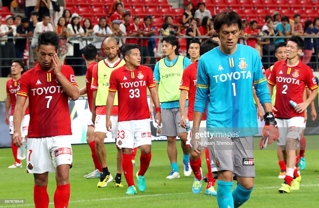 Nagoya Grampus players leave the pitch after their team's 11 draw in the JLeague match between Nagoya Grampus and FC Tokyo at Toyota Stadium on...
