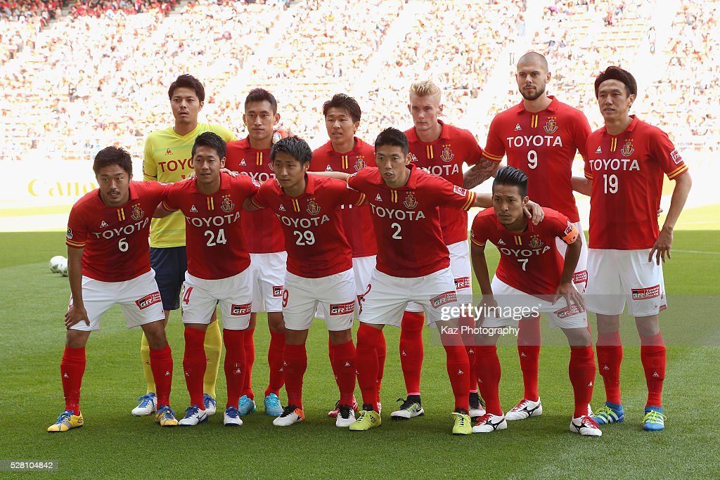 Nagoya Grampus players line up for the team photos prior to the J.League match between Nagoya Grampus and Yokohama F.Marinos at the Toyota Stadium on May 4, 2016 in Toyota, Aichi, Japan.