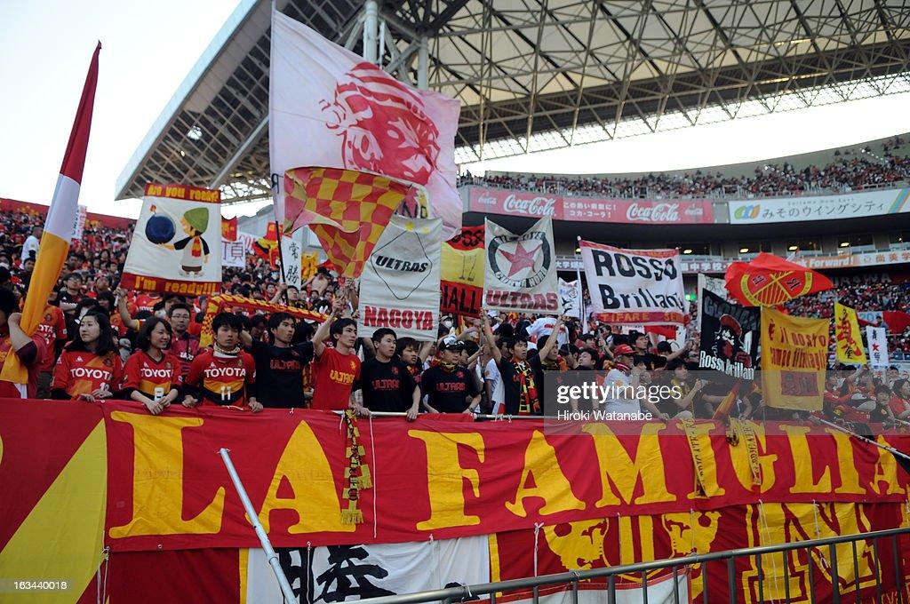 Nagoya Grampus supporters cheer during the J.League match between Urawa Red Diamonds and Nagoya Grampus at Saitama Stadium on March 9, 2013 in Saitama, Japan.