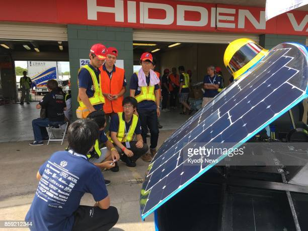 Nagoya Institute of Technology team members discuss their solar car performance in time trials in Darwin on Oct 8 before competing in a 3000kilometer...