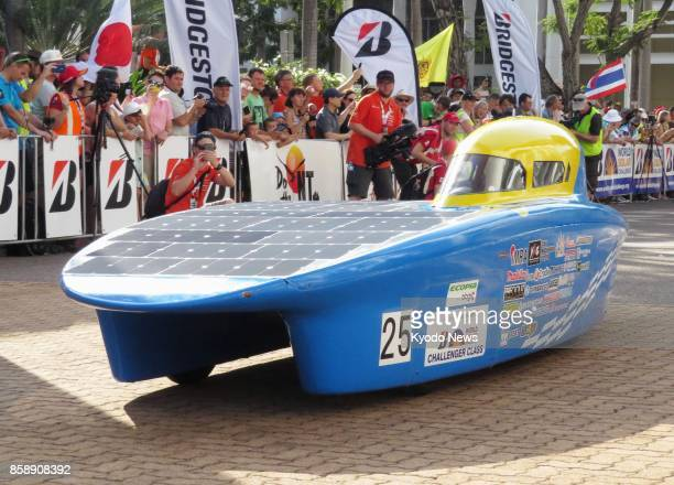 A Nagoya Institute of Technology team's solar car stands at the start in Darwin on Oct 8 2017 of the World Solar Challenge a 3000kilometer endurance...