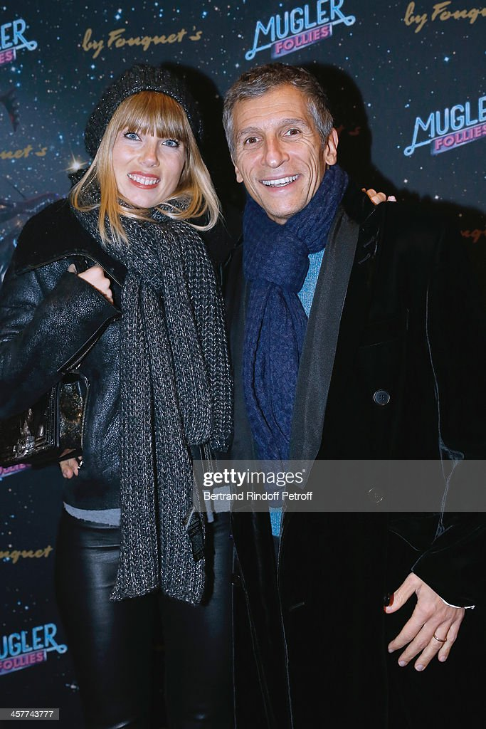 <a gi-track='captionPersonalityLinkClicked' href=/galleries/search?phrase=Nagui&family=editorial&specificpeople=765035 ng-click='$event.stopPropagation()'>Nagui</a> (R) and his wife actress Melanie Page attend the 'Mugler Follies' Paris new variety show premiere on December 18, 2013, held at 'Le Comedia' Theater in Paris, France.