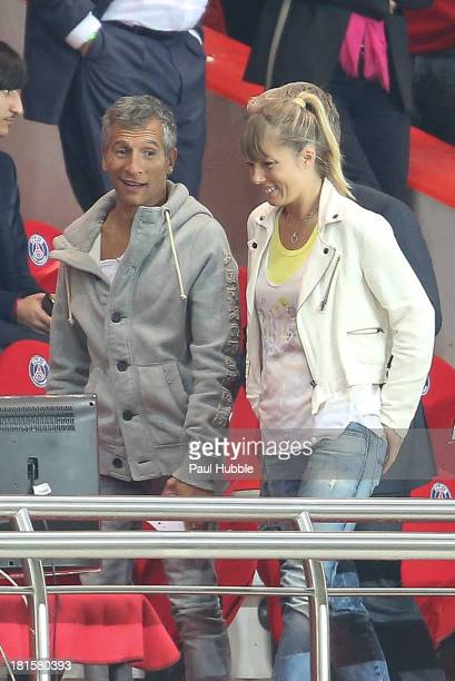Nagui and his wife Melanie Page are seen during the Paris Saint Germain FC vs AS Monaco FC at Parc des Princes on September 22 2013 in Paris France