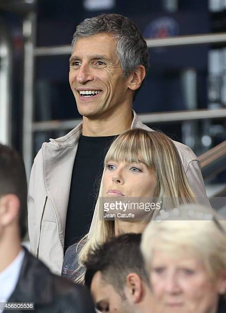 Nagui and his wife Melanie Page attend the UEFA Champions League Group F match between Paris SaintGermain FC and FC Barcelona at the Parc des Princes...