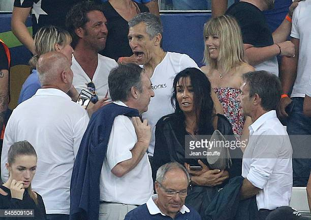 Nagui and his wife Melanie Page below JeanPierre Bernes celebrate the victory following the UEFA Euro 2016 semifinal match between Germany and France...
