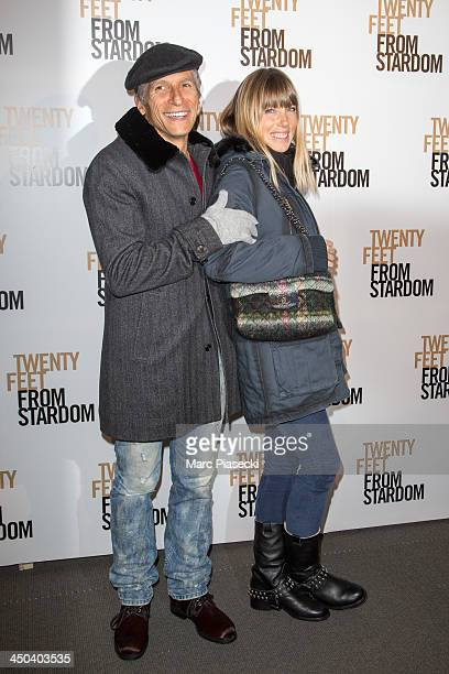 Nagui and wife Melanie Page attend the 'Twenty feet from stardom' Paris premiere at Cinema UGC Normandie on November 18 2013 in Paris France