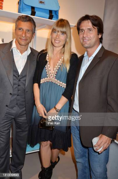 Nagui Melanie Page and Fabrice Santoro attend the Lacoste Flagship Store Opening Party at Lacoste Champs Elysees on April 28 2011 in Paris France