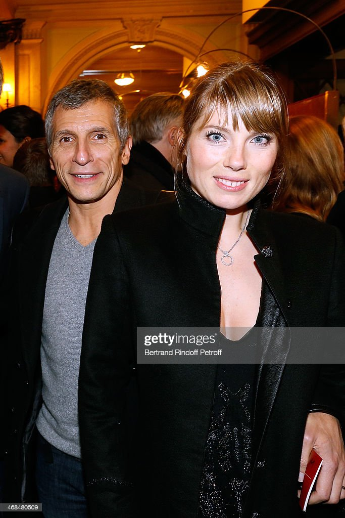<a gi-track='captionPersonalityLinkClicked' href=/galleries/search?phrase=Nagui&family=editorial&specificpeople=765035 ng-click='$event.stopPropagation()'>Nagui</a> with his wife actress Melanie Page attend 'La Porte a Cote' : Theater Play premiere. Held at Theatre Edouard VII on February 10, 2014 in Paris, France.